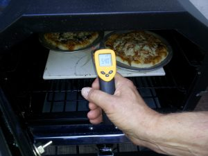 Pizza stone to temp. By the way, if you don't have one of the handy infrared thermometer guns, you can find one cheap on eBay. They are as essential as a good spoon.